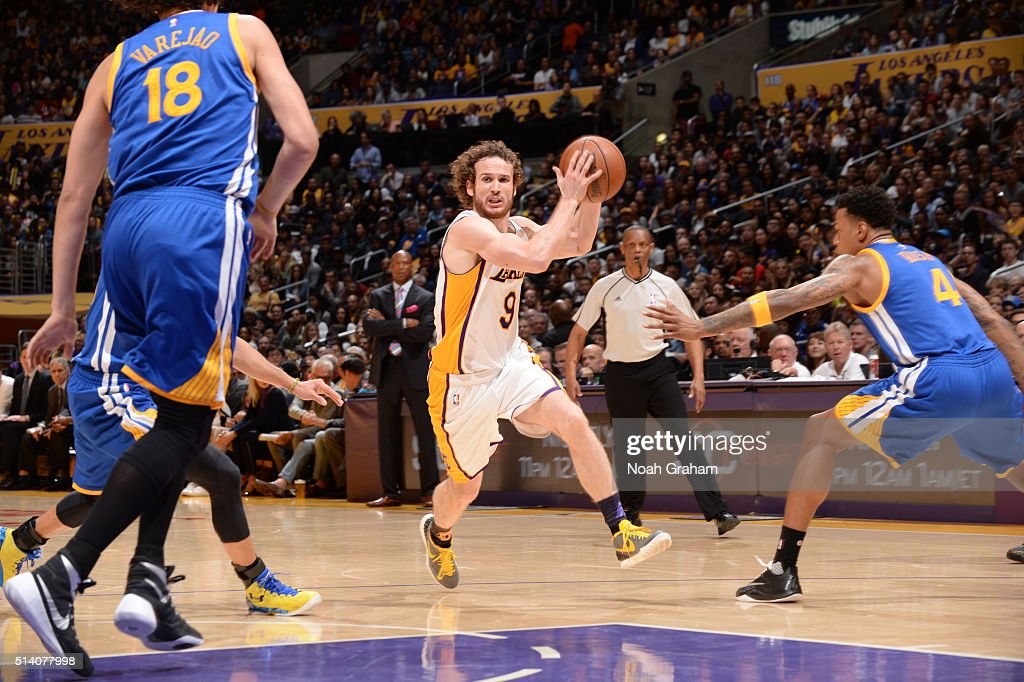 Marcelo Huertas #9 of the Los Angeles Lakers handles the ball against the Golden State Warriors on March 6, 2016 at STAPLES Center in Los Angeles, California.