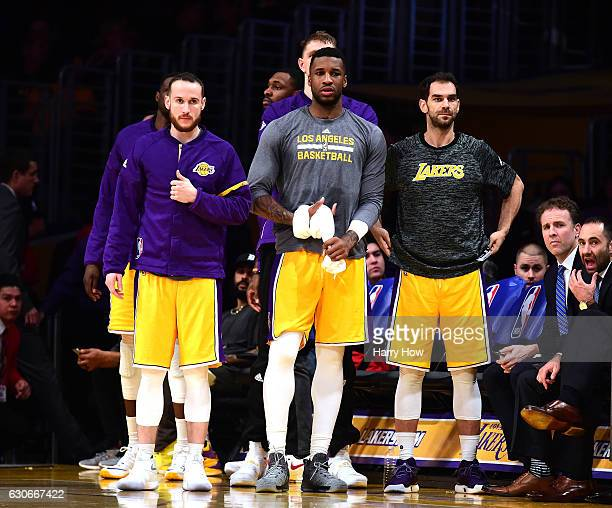 Marcelo Huertas Thomas Robinson and Jose Calderon of the Los Angeles Lakers look on during a 10189 Dallas Mavericks win at Staples Center on December...