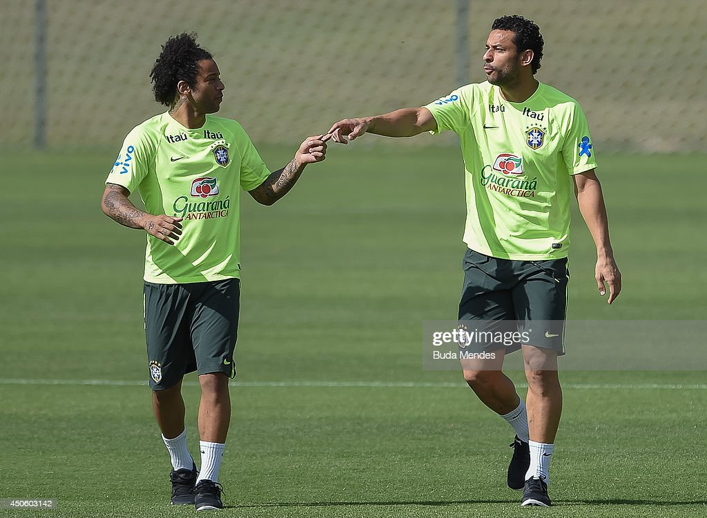 Marcelo (L) jokes with a Fred during a training session of the Brazilian national football team at the squad's Granja Comary training complex, on June 14, 2014 in Teresopolis, 90 km from downtown Rio de Janeiro, Brazil.