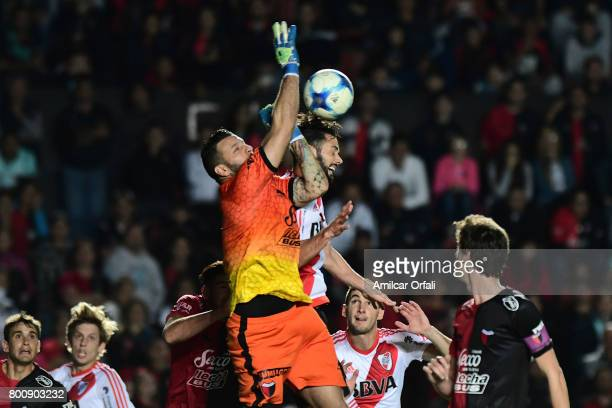 Marcelo Larrondo of River Plate fights for the ball with Jorge Broun of Colon during a match between Colon and River Plate as part of Torneo Primera...