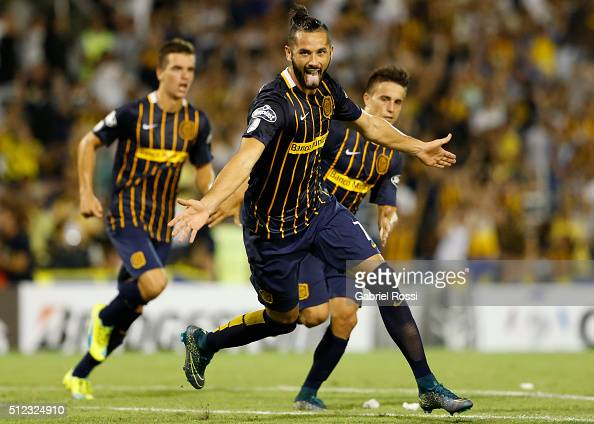 Marcelo Larrondo of Rosario Central celebrates after scoring the first goal of his team during a group stage match between Rosario Central and...
