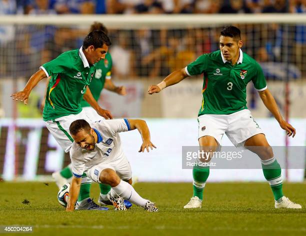 Marcelo Martins Moreno of Bolivia is gets tangled up with Ioannis Fetfatzidis of Greece as Luis Alberto Gutierrez of Bolivia looks on during the...