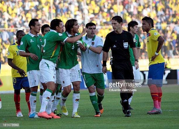 Marcelo Martins of Bolivia reacts with referee Juan Soto during a match between Ecuador and Bolivia as part of the South American Qualifiers for the...