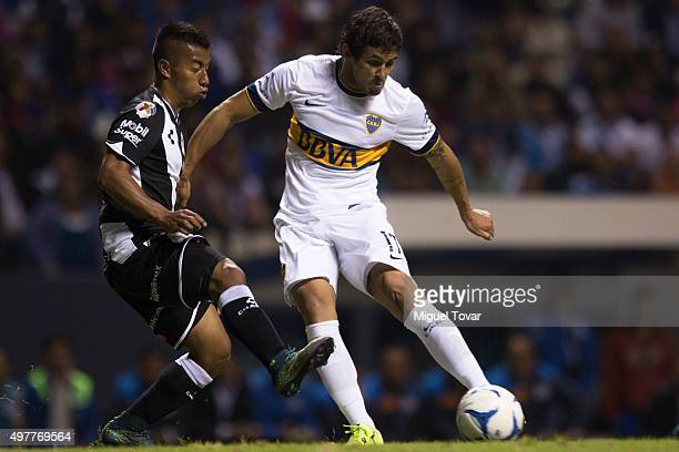 Marcelo Meli of Boca Juniors kicks the ball during the opening friendly match between Puebla and Boca Juniors at Cuauhtemoc Stadium on November 18...
