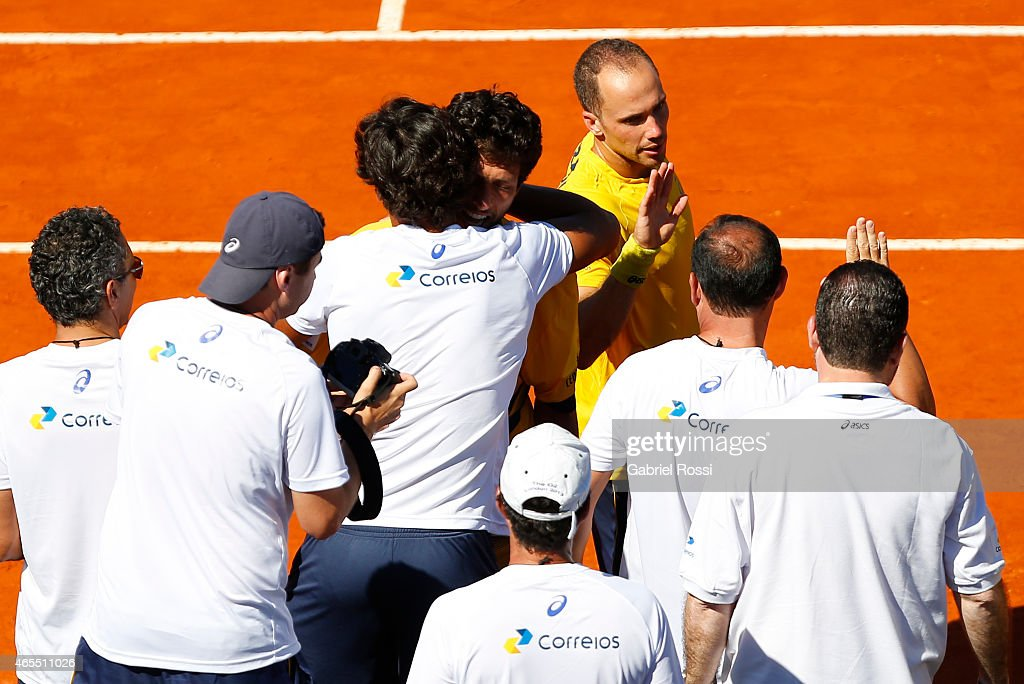 <a gi-track='captionPersonalityLinkClicked' href=/galleries/search?phrase=Marcelo+Melo&family=editorial&specificpeople=4278628 ng-click='$event.stopPropagation()'>Marcelo Melo</a> and <a gi-track='captionPersonalityLinkClicked' href=/galleries/search?phrase=Bruno+Soares+-+Tennis+Player&family=editorial&specificpeople=11650044 ng-click='$event.stopPropagation()'>Bruno Soares</a> (BRA) celebrate after wining the doubles match between <a gi-track='captionPersonalityLinkClicked' href=/galleries/search?phrase=Carlos+Berlocq&family=editorial&specificpeople=553854 ng-click='$event.stopPropagation()'>Carlos Berlocq</a> / Diego Schwartzman (ARG) v <a gi-track='captionPersonalityLinkClicked' href=/galleries/search?phrase=Marcelo+Melo&family=editorial&specificpeople=4278628 ng-click='$event.stopPropagation()'>Marcelo Melo</a> / <a gi-track='captionPersonalityLinkClicked' href=/galleries/search?phrase=Bruno+Soares+-+Tennis+Player&family=editorial&specificpeople=11650044 ng-click='$event.stopPropagation()'>Bruno Soares</a> (BRA) as part of Davis Cup 2015 match between Argentina and Brazil at Tecnopolis on March 07, 2015 in Villa Martelli, Buenos Aires, Argentina.
