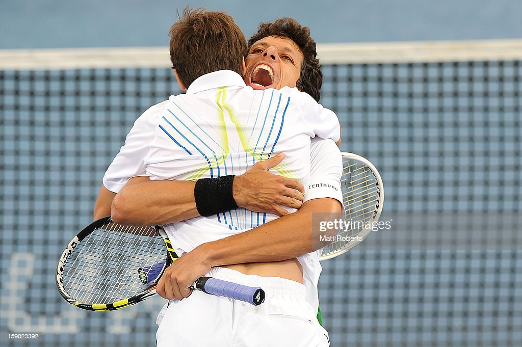 Marcelo Melo and Tommy Robredo celebrate winning their doubles final against Eric Butorac and Paul Hanley on day eight of the Brisbane International at Pat Rafter Arena on January 6, 2013 in Brisbane, Australia.