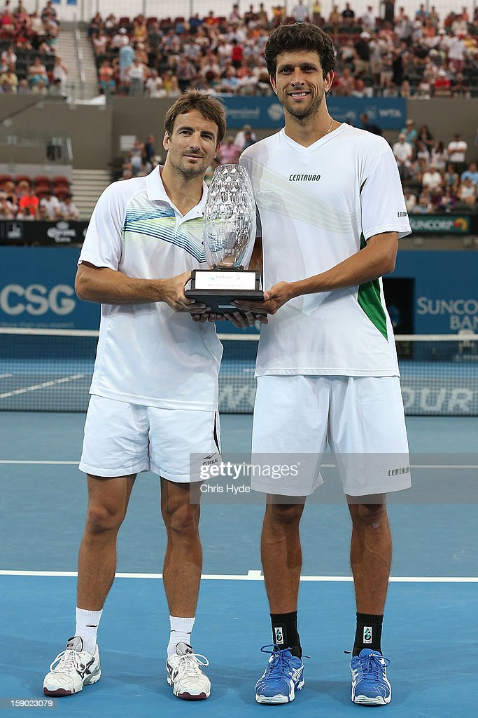 Marcelo Melo and Tommy Robredo hold the winners trophy after their doubles final against Eric Butorac and Paul Hanley during day eight of the Brisbane International at Pat Rafter Arena on January 6, 2013 in Brisbane, Australia.