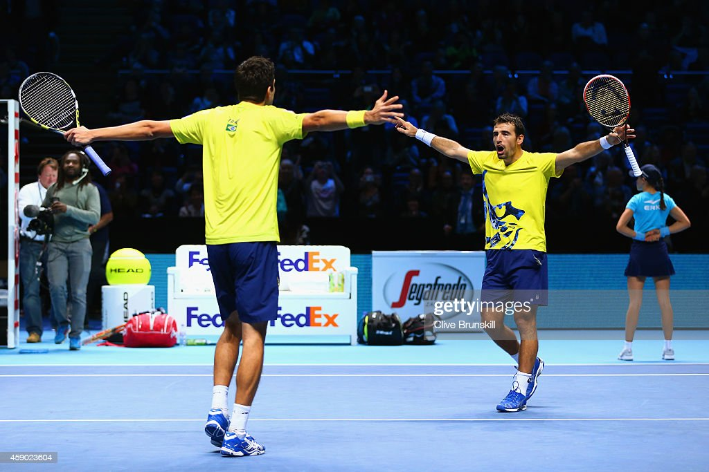 <a gi-track='captionPersonalityLinkClicked' href=/galleries/search?phrase=Marcelo+Melo&family=editorial&specificpeople=4278628 ng-click='$event.stopPropagation()'>Marcelo Melo</a> of Brazil and <a gi-track='captionPersonalityLinkClicked' href=/galleries/search?phrase=Ivan+Dodig&family=editorial&specificpeople=4888715 ng-click='$event.stopPropagation()'>Ivan Dodig</a> of Croatia celebrate match point in the doubles semi-final match against Lukasz Kubot of Poland and Robert Lindstedt of Sweden on day seven of the Barclays ATP World Tour Finals at O2 Arena on November 15, 2014 in London, England.