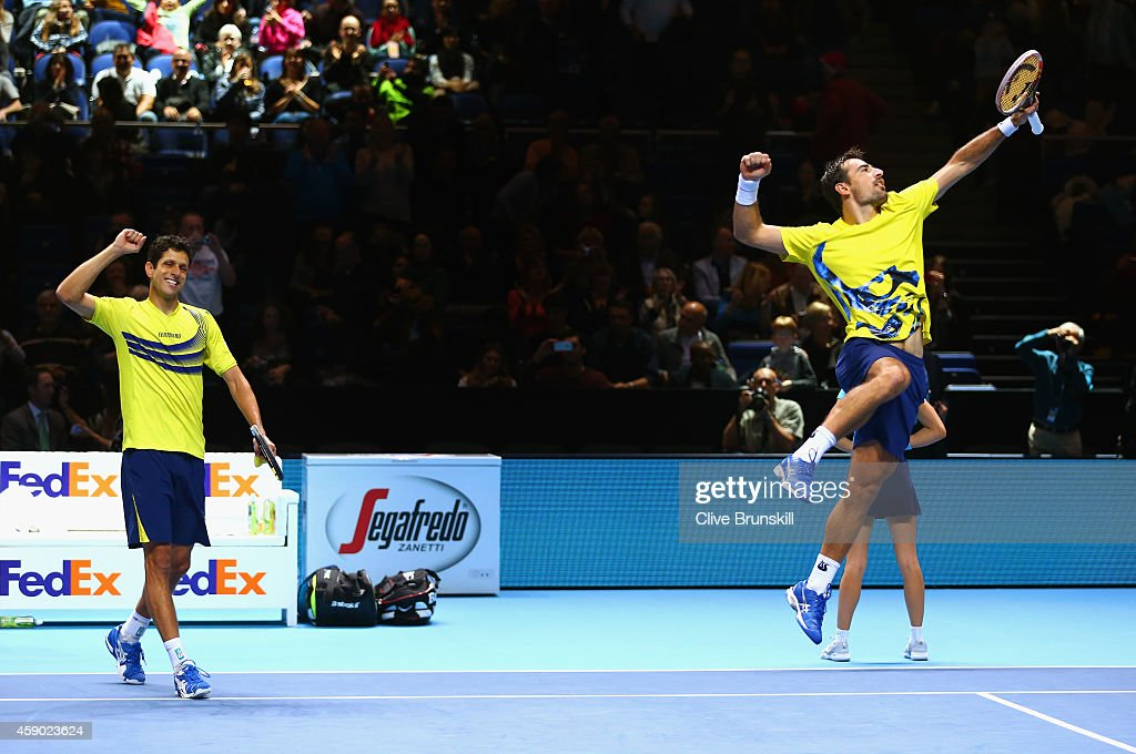 Marcelo Melo of Brazil and Ivan Dodig of Croatia celebrate match point in the doubles semi-final match against Lukasz Kubot of Poland and Robert Lindstedt of Sweden on day seven of the Barclays ATP World Tour Finals at O2 Arena on November 15, 2014 in London, England.