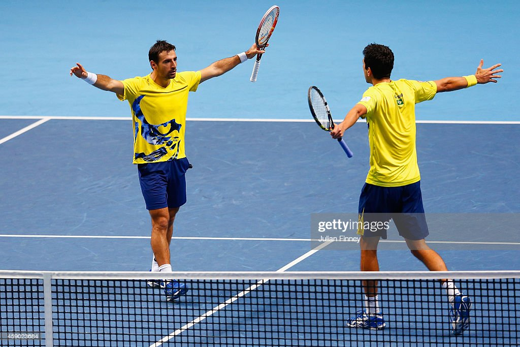 Marcelo Melo of Brazil and Ivan Dodig of Croatia (L) celebrate match point in the doubles semi-final match against Lukasz Kubot of Poland and Robert Lindstedt of Sweden on day seven of the Barclays ATP World Tour Finals at O2 Arena on November 15, 2014 in London, England.