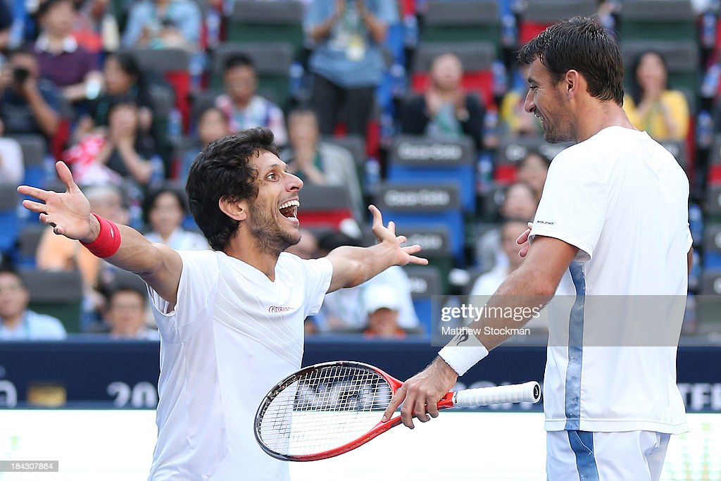 Marcelo Melo of Brazil and Ivan Dodig of Croatia celebrate match point against David Marrero and Fernando Verdasco of Spain during the doubles final of the Shanghai Rolex Masters at the Qi Zhong Tennis Center on October 13, 2013 in Shanghai, China.