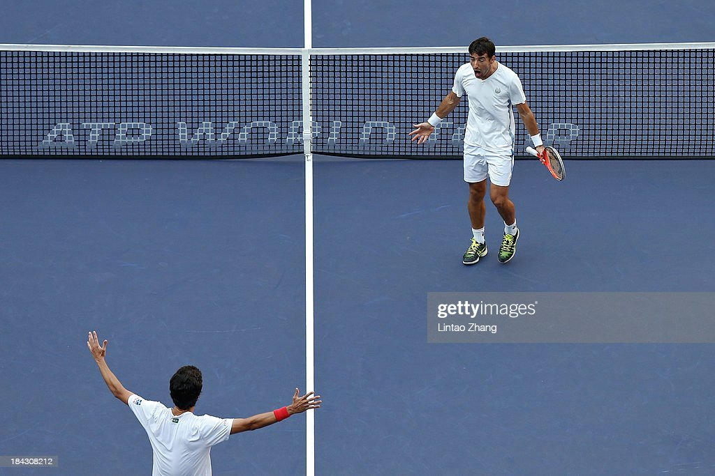 Marcelo Melo of Brazil and Ivan Dodig of Croatia celebrates after winning match against David Marrero and Fernando Verdasco of Spain during the doubles final of the Shanghai Rolex Masters at the Qi Zhong Tennis Center on October 13, 2013 in Shanghai, China.