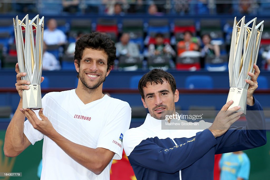 Marcelo Melo of Brazil and Ivan Dodig of Croatia pose for photographers after defeaitng David Marrero and Fernando Verdasco of Spain during the doubles final of the Shanghai Rolex Masters at the Qi Zhong Tennis Center on October 13, 2013 in Shanghai, China.