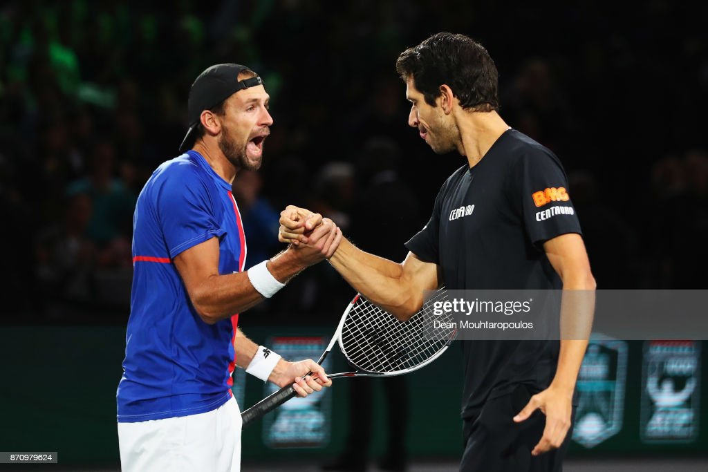 Marcelo Melo of Brazil and Lukasz Kubot of Poland celebrate match point, winning the Mens Doubles Final against Marcel Granollers of Spain and Ivan Dodig of Croatia during Day 7 of the Rolex Paris Masters held at the AccorHotels Arena on November 5, 2017 in Paris, France.