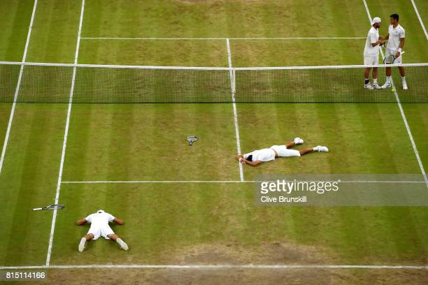 Marcelo Melo of Brazil and Lukasz Kubot of Poland celebrate championship point and victory during the Gentlemen's Doubles final against Oliver Marach...