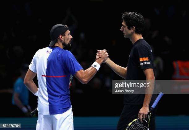 Marcelo Melo of Brazil and Lukasz Kubot of Poland celebrate victory during the doubles match against Bob Bryan of The United States and Mike Bryan of...