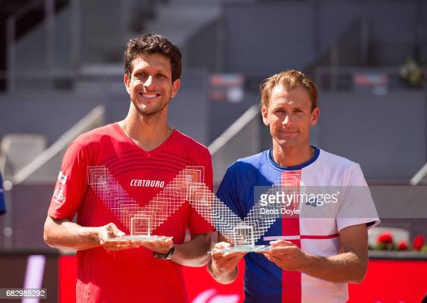 Marcelo Melo of Brazil and Lukasz Kubot of Poland celebrate with their trophies after beating Nicolas Mahut and Edouard RogerVasselin of France in...