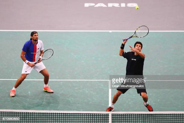 Marcelo Melo of Brazil and Lukasz Kubot of Poland compete in the Mens Doubles Final against Marcel Granollers of Spain and Ivan Dodig of Croatia...