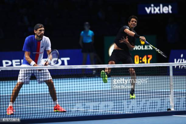 Marcelo Melo of Brazil and Lukasz Kubot of Poland in action in the Doubles Semi Final match against Ryan Harrison of the United States and Michael...