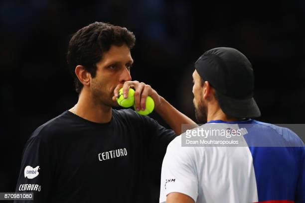 Marcelo Melo of Brazil and Lukasz Kubot of Poland speak as they compete in the Mens Doubles Final against Marcel Granollers of Spain and Ivan Dodig...