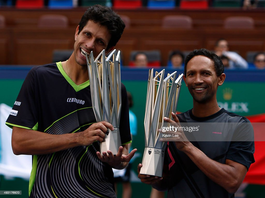 Marcelo Melo of Brazil and Raven Klaasen of Republic of South Africa hold their trophy at the award ceremony after winning the match against Simone Bolelli of Italy and Fabio Fognini of Italy during their men's double final on day 8 of Shanghai Rolex Masters at Qi Zhong Tennis Centre on October 18, 2015 in Shanghai, China.