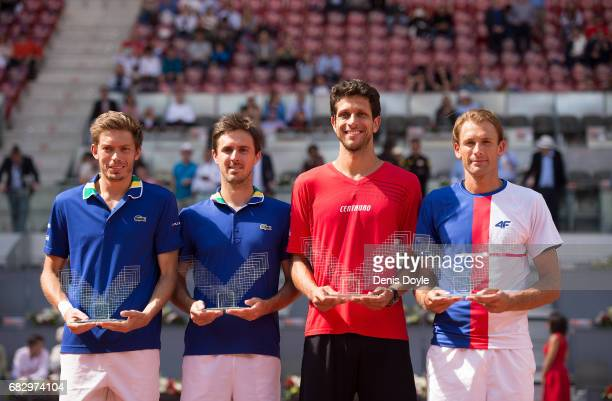 Marcelo Melo of Brazil and teammate Lukasz Kubot of Poland celebrate with their winners trophies along with with runners up Nicolas Mahut and Edouard...