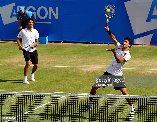 Marcelo Melo of Brazil plays a smash playing with Andre Sa of Brazil during the men's doubles semi final match against Jeff Coetzee of South Africa...