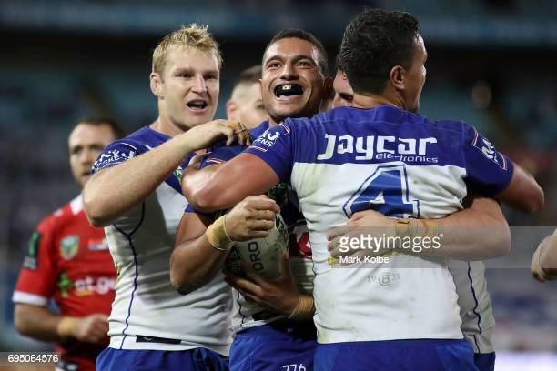 Marcelo Montoya of the Bulldogs celebrates with his team mates after scoring a try during the round 14 NRL match between the Canterbury Bulldogs and...