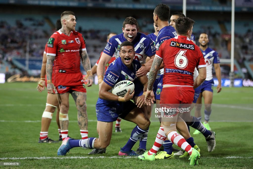 Marcelo Montoya of the Bulldogs celebrates with his team mates after scoring a try during the round 14 NRL match between the Canterbury Bulldogs and the St George Illawarra Dragons at ANZ Stadium on June 12, 2017 in Sydney, Australia.