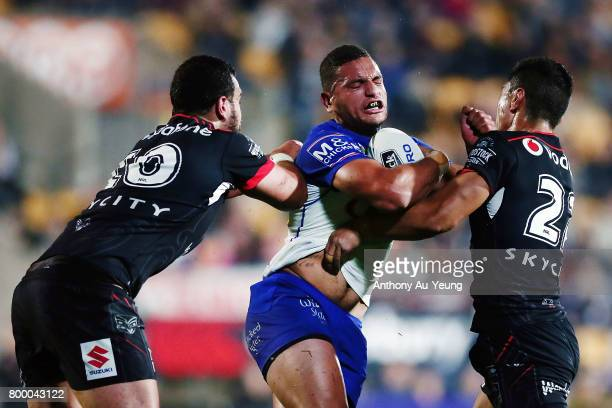 Marcelo Montoya of the Bulldogs is tackled by Ben Matulino and Ata Hingano of the Warriors during the round 16 NRL match between the New Zealand...