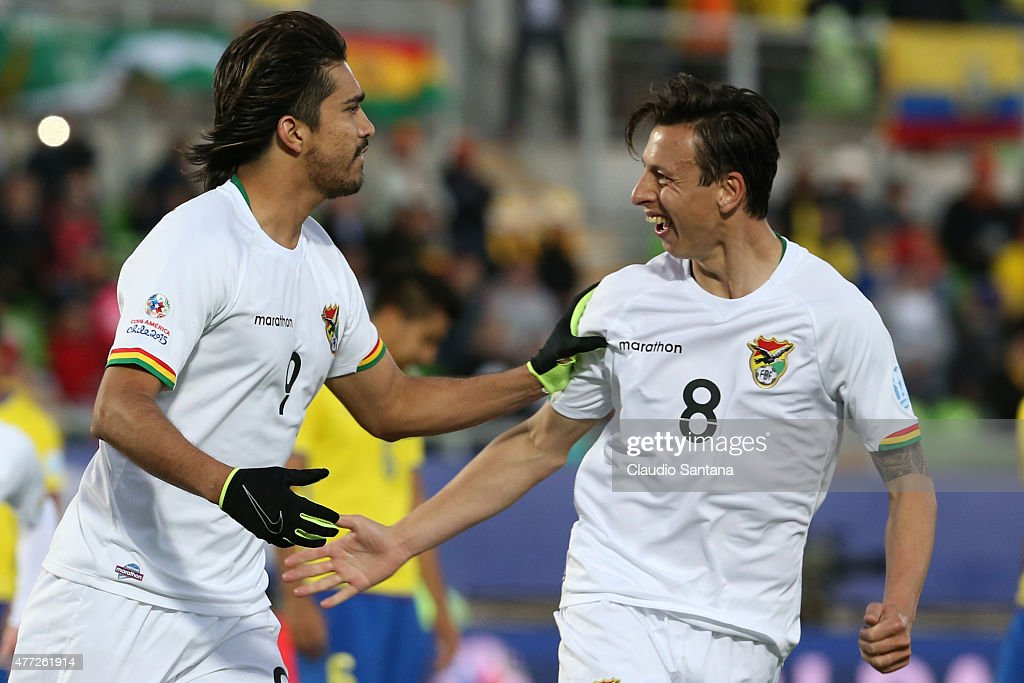 Marcelo Moreno Martins of Bolivia celebrates with teammate Martin SmedbergDalance after scoring the third goal of his team through a penalty kick...