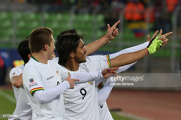 Marcelo Moreno Martins of Bolivia celebrates with teammates after scoring the third goal of his team through a penalty kick during the 2015 Copa...