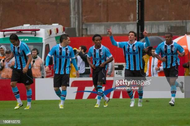 Marcelo Moreno Ze Roberto Elano and Fernando of Gremio celebrate a scored goal by Elano against Internacional during a match as part of Brasileiro...