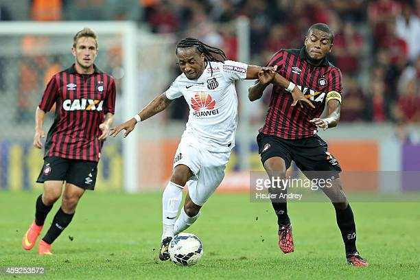 Marcelo of AtleticoPR competes for the ball with Arouca of Santos during the match between AtleticoPR and Santos for the Brazilian Series A 2014 at...