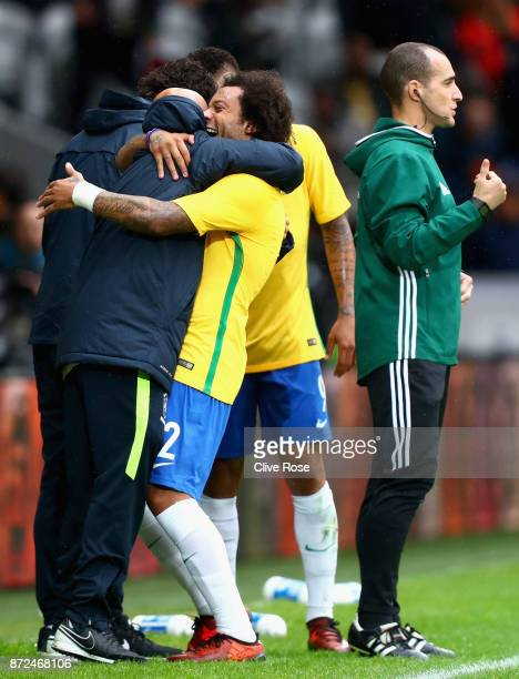 Marcelo of Brazil celebrates with a staff member after scoring his sides second goal during the international friendly match between Brazil and Japan...