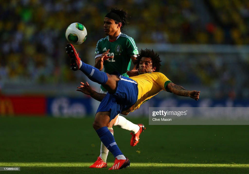 Marcelo of Brazil competes with Gerardo Flores of Mexico during the FIFA Confederations Cup Brazil 2013 Group A match between Brazil and Mexico at Castelao on June 19, 2013 in Fortaleza, Brazil.