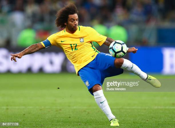 Marcelo of Brazil kicks the ball with of Ecuador during a match between Brazil and Ecuador as part of 2018 FIFA World Cup Russia Qualifier at Arena...