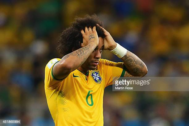 Marcelo of Brazil reacts after allowing a goal during the 2014 FIFA World Cup Brazil Semi Final match between Brazil and Germany at Estadio Mineirao...