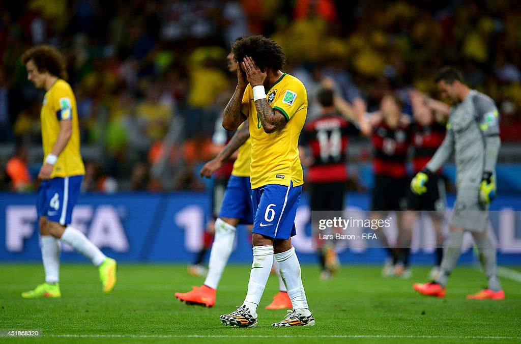 Marcelo of Brazil reacts after conceding the seventh goal to Germany during the 2014 FIFA World Cup Brazil Semi Final match between Brazil and Germany at Estadio Mineirao on July 8, 2014 in Belo Horizonte, Brazil.