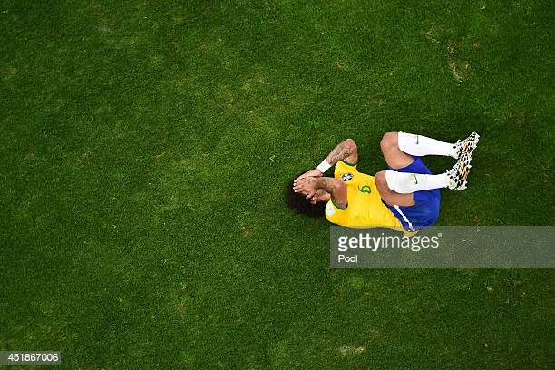 Marcelo of Brazil reacts during the 2014 FIFA World Cup Brazil Semi Final match between Brazil and Germany at Estadio Mineirao on July 8 2014 in Belo...