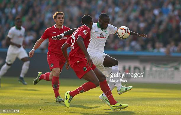 Marcelo of Hannover battles for the ball with Anthony Ujah of Bremen during the Bundesliga match between Hannover 96 and Werder Bremen at HDIArena on...