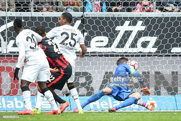 Marcelo of Hannover scores his team's first goal against goalkeeper Kevin Trapp of Frankfurt during the Bundesliga match between Eintracht Frankfurt...
