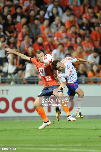 Marcelo of Omiya Ardija and Masaru Kato of Albirex Niigata compete for the ball during the JLeague J1 match between Omiya Ardija and Albirex Niigata...