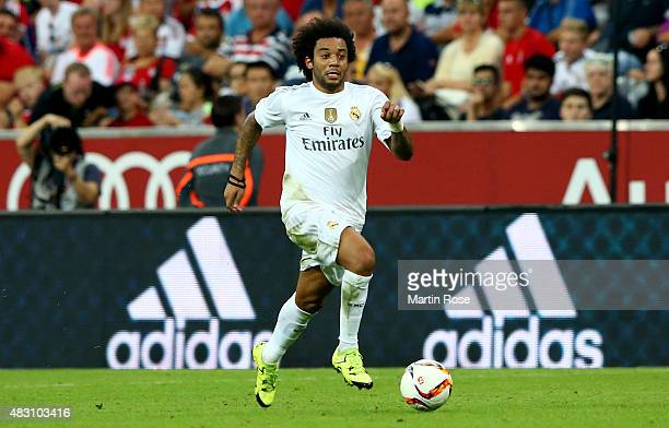Marcelo of Real Madird runs with the ball during the Audi Cup 2015 final match between FC Bayern Muenchen and Real Madrid at Allianz Arena on August...
