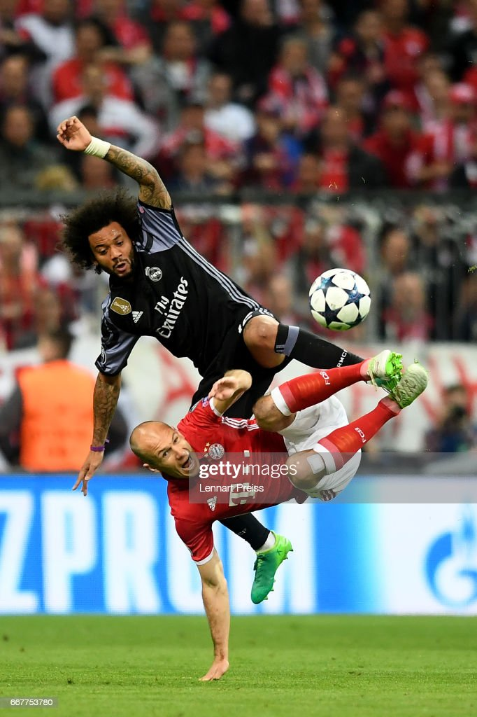 Marcelo of Real Madrid and Arjen Robben of Bayern fight for the ball during the UEFA Champions League Quarter Final first leg match between FC Bayern Muenchen and Real Madrid CF at Allianz Arena on April 12, 2017 in Munich, Germany.