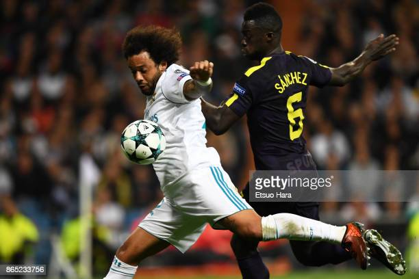 Marcelo of Real Madrid and Davinson Sanchez of Tottenham Hotspur compete for the ball during the UEFA Champions League group H match between Real...