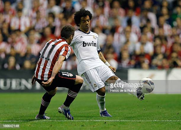 Marcelo of Real Madrid and Ibai Gómez of Athletic Club compete for the ball during the La Liga match between Athletic Club and Real Madrid at San...
