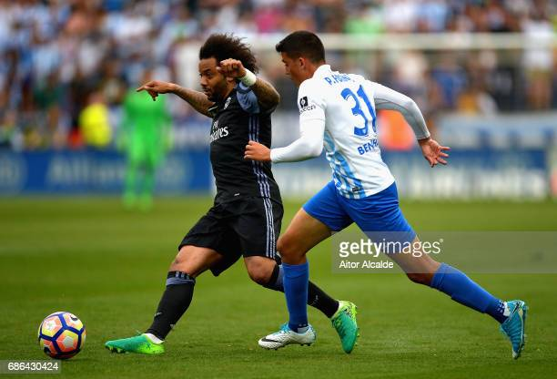 Marcelo of Real Madrid and Pablo Fornals of Malaga in action during the La Liga match between Malaga and Real Madrid at La Rosaleda Stadium on May 21...