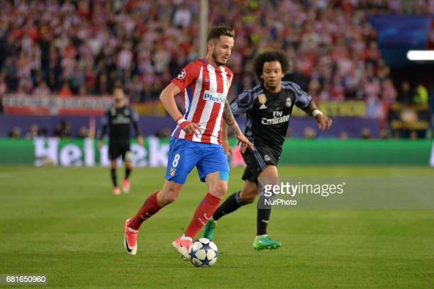 Marcelo of Real Madrid and Saul of Atletico de Madrid in action during the match between Real Madrid CF vs Atletico de Madrid as part of EUFA...
