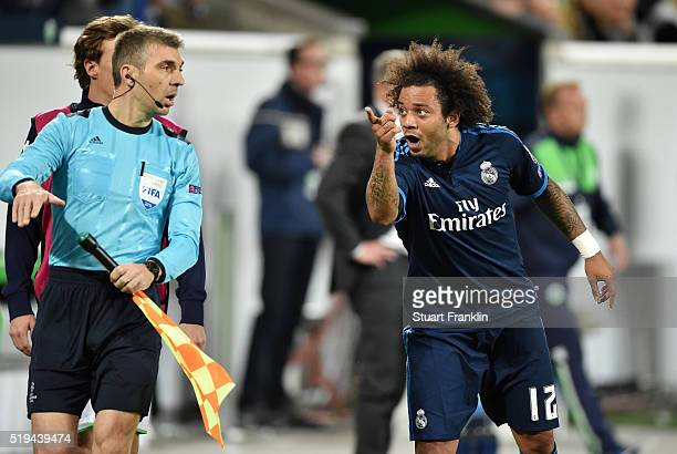 Marcelo of Real Madrid appeals to an assistant referee during the UEFA Champions League Quarter Final First Leg match between VfL Wolfsburg and Real...